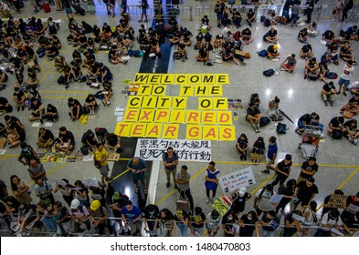 HONG KONG - AUG 10 2019: Protesters at Hong Kong International Airport telling the story of protests and police brutality to tourist and visitors