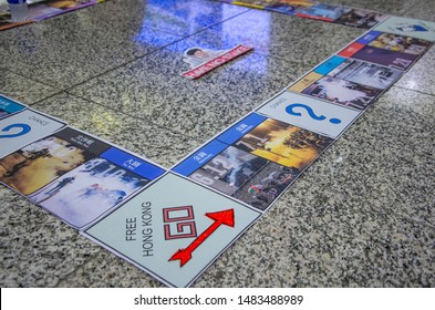 HONG KONG - AUG 10 2019: Protesters Monopoly-like props at Hong Kong International Airport telling the story of protests and police brutality to tourist and visitors