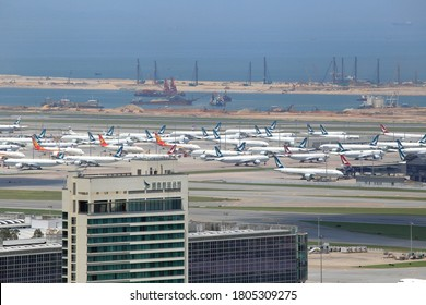 Hong Kong - Aug 23, 2020 - Cathay Pacific building and planes parked at Hong Kong International Airport in Hong Kong on Aug 23, 2020.  The airline industry suffered huge losses due to the pandemic.