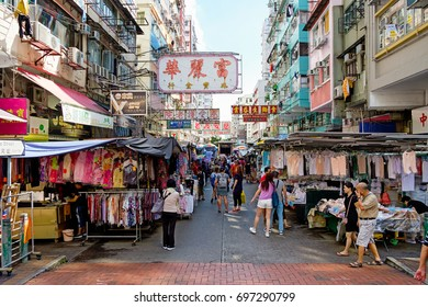 Hong Kong - August 11 2017: Market sale of Clothes on the sidewalk road in Sham Shui Po, Kowloon.