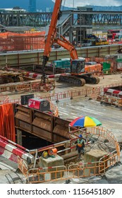 Hong Kong, August 13, 2018: Workers are seen working at the construction site of MTR's Exhibition Centre Station in Wanchai. The excavation work has been suspended due to reports of subsidence.