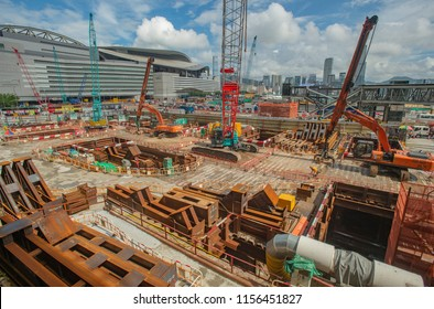 Hong Kong, August 13, 2018: Workers are seen working at the construction site of MTR's Exhibition Centre Station in Wan Chai. The excavation work has been suspended due to reports of subsidence.