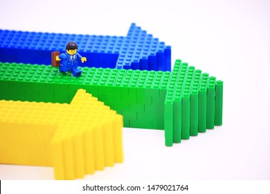 Hong Kong - August 13 2019: the Lego mini characters is walking on the arrow. Lego miniature are the successful line in Lego products.