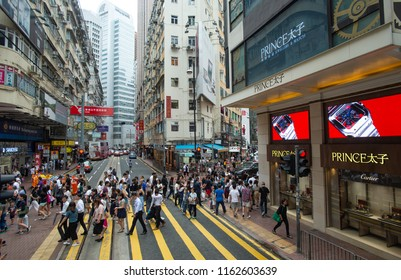 Hong Kong - August 16, 2018: Pedestrians are seen crossing the tracks of trams in Causeway, Hong Kong. Since 1904, trams have been running along the northern coast of Hong Kong Island.