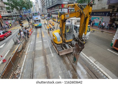 Hong Kong - August 16, 2018: Workers are seen working on the tracks of trams in Wan Chai, Hong Kong. Since 1904, trams have been running along the northern coast of Hong Kong Island.