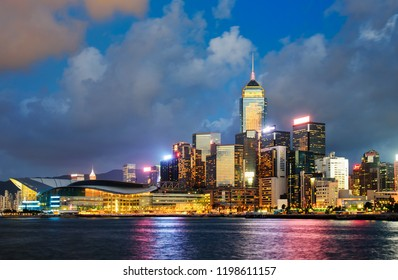 Hong Kong - August 8, 2018: Hong Kong view from the central pier with downtown cityscape view over water from the city pier at blue hour