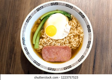Hong Kong breakfast, sunny side up fried egg and luncheon meat on instant noodle