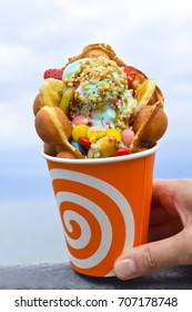 Hong Kong bubble waffle with ice cream caramel syrup  in orange cup