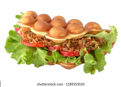 Hong Kong bubble waffles. Street food. Big and tasty nourishing gourmet sandwich. Isolated on white