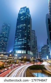 Hong Kong Business District at Night with Light Track