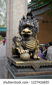 Hong Kong, China, 11/09/2014, Bronze sculpture of a lion on the territory of the temple complex Wong Tai Sin. At the gate of the temple complex Wong Tai Sin.