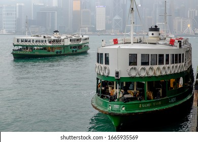 Hong Kong, China, 12/31/2019 Two famous Star ferries pass each other on New Years Eve.