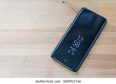 "Hong Kong, China - 14 March, 2018: Samsung Galaxy S9 with ""Always on Display"" on a wooden surface."