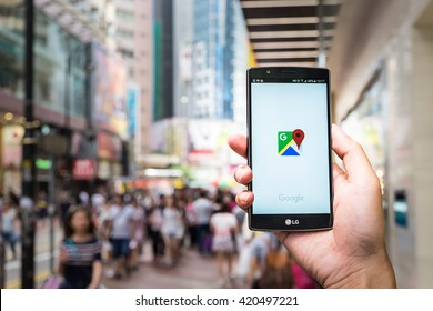 HONG KONG, CHINA - 15 MAY 2016: A man hand holding screen shot of google maps app showing on LG G4. Google Maps is most popular mapping service for mobile provided by Google.