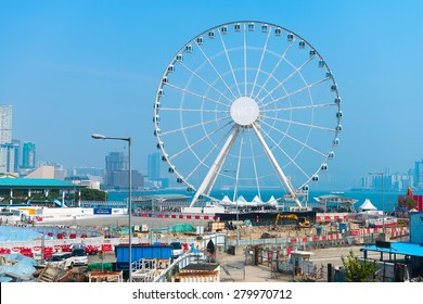 HONG KONG, CHINA - 18 JAN 2015: Massive ferris wheel dominates the skyline with the bay in the background, in Hong Kong, China.
