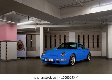 Hong Kong, China - 23/01/2019: A rare, blue Porsche 911 (993) Turbo parking in an underground garage on the prestigious Hong Kong Island. This vintage sports car is particularly rare in blue colour.