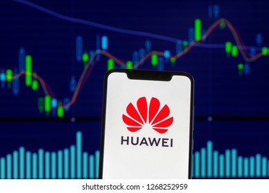 Hong Kong, China - 27 December 2018: Huawei logo is seen on an android mobile phone over stock chart