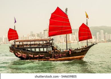Hong Kong, China - 27 September, 2012: Traditional Chinese junk boat crossing Victoria Harbor