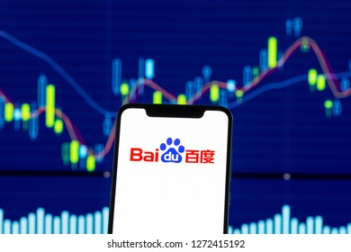 Hong Kong, China - 28 December 2018:   Baidu logo is seen on an android mobile phone over stock chart
