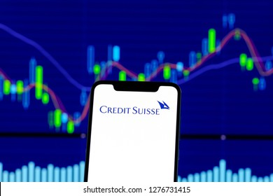 Hong Kong, China - 28 December 2018: Credit Suisse logo is seen on an smartphone over stock chart