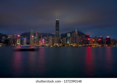 HONG KONG, CHINA - 30 MARCH 2019: Blue hour sunset Hong Kong skyline at Victoria Harbour from Harbour City.