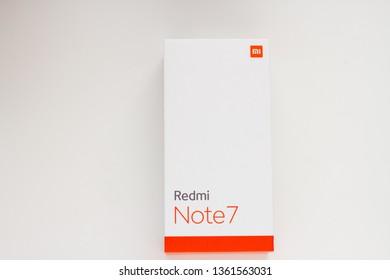 Hong Kong; Hong Kong; China- 4  April 2019: Xiaomi Redmi Note 7 box with new smartphone isolated. flagship