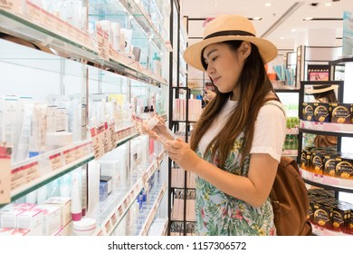 Hong Kong, China : 5/08/2018 : Tourist is selecting cosmetic in the shop while travling at Hong Kong, China.