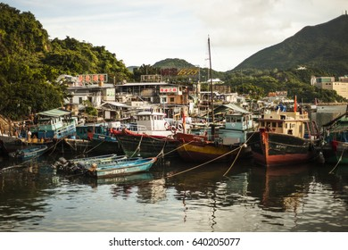 Hong Kong, China - 8 July, 2013: Boats docked at the Lei Yue Mun fishing village in Kowloon on a sunny afternoon