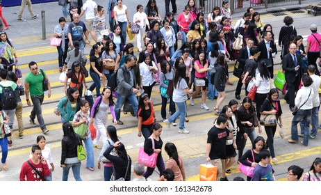 HONG KONG, CHINA - APR 13: Crowded street view on April 13, 2013 in Hong Kong, China. With 7M population and land mass of 1104 sq km, it is one of the most dense areas in the world.