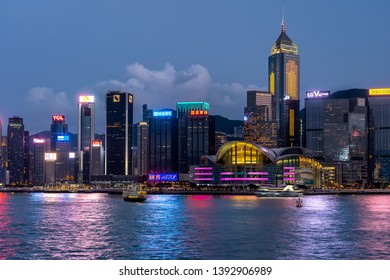 Hong Kong, China - Apr 22, 2019: Office buildings and Convention and Exhibition centre illuminated at night