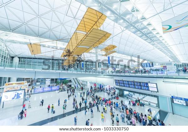 Hong Kong, China - April 04, 2016 : Arrival Hall in Hong Kong International Airport. It handles more than 70 million passengers per year.