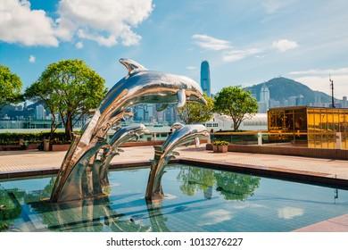 Hong Kong, China. April 10, 2017. Silver dolphin sculpture in Hong Kong by the sea shore.