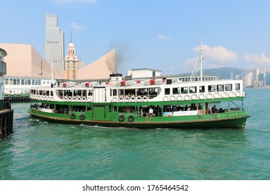 Hong Kong, China - April 30, 2017: Tourists enjoy sailing on traditional Star ferry steamboat in Victoria harbour with famous skyline in the back in Hong Kong.