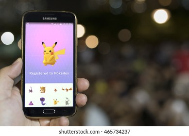 HONG KONG, CHINA - August 08 2016 : An Android user plays Pokemon Go, a free-to-play augmented reality mobile game developed by Niantic for iOS and Android devices.