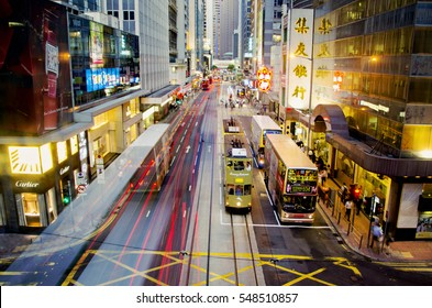 HONG KONG, CHINA - AUGUST 18, 2013: Tram and bus traffic in Des Voeux Road Central.