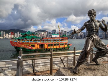 Hong Kong, China - August 29, 2018: Statue of Bruce Lee along the Avenue of the Stars with the city center backdrop