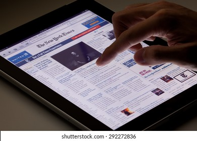 Hong Kong, China - August 7, 2011: Image of browsing the New York Times website using an ipad. The New York Times is a popular American daily newspaper and its website is the most popular American