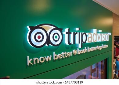HONG KONG, CHINA - CIRCA APRIL, 2019: close up shot of TripAdvisor sign in a store at Hong Kong International Airport.