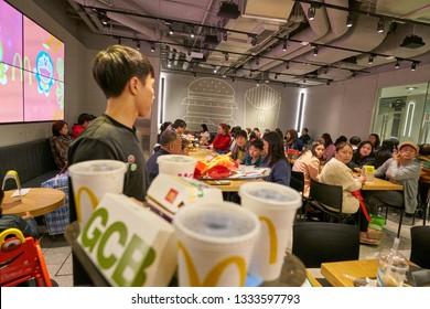 HONG KONG, CHINA - CIRCA FEBRUARY, 2019: worker with tray in McDonald's restaurant in Hong Kong.