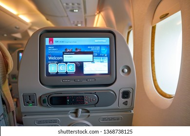 HONG KONG, CHINA - CIRCA FEBRUARY, 2019: Emirates ICE (Information, Communication, Entertainment) inflight entertainment in Economy Class of Emirates Airbus A380.