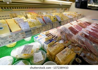 HONG KONG, CHINA - CIRCA FEBRUARY, 2019: cheeses and meat products display at AEON supermarket in Hong Kong.