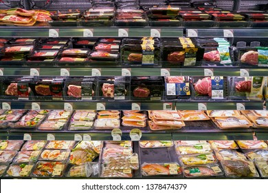 HONG KONG, CHINA - CIRCA JANUARY, 2019: various meat products and assorted seafood on display at ThreeSixty supermarket in Elements shopping mall in Hong Kong.