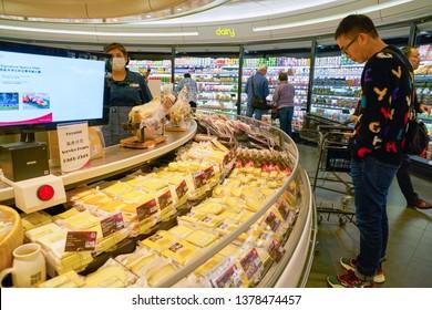 HONG KONG, CHINA - CIRCA JANUARY, 2019: assorted cheeses on display at ThreeSixty supermarket in Elements shopping mall in Hong Kong.