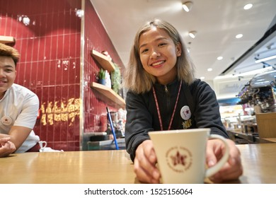 HONG KONG, CHINA - CIRCA JANUARY, 2019: indoor portrait of a barista at Pret a Manger. Pret a Manger is an international sandwich shop chain based in the United Kingdom.