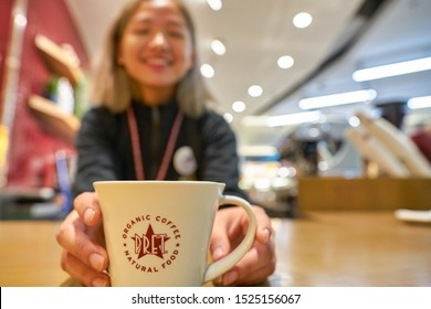 HONG KONG, CHINA - CIRCA JANUARY, 2019: barista hold a cup at Pret a Manger. Pret a Manger is an international sandwich shop chain based in the United Kingdom.