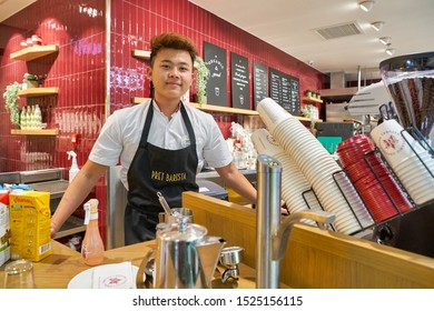 HONG KONG, CHINA - CIRCA JANUARY, 2019: indoor portrait of barista in Pret a Manger. Pret a Manger is an international sandwich shop chain based in the United Kingdom.