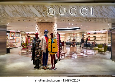 HONG KONG, CHINA - CIRCA JANUARY, 2019: Gucci brand name over shop entrance at Elements shopping mall. Gucci is an Italian luxury brand of fashion and leather goods.