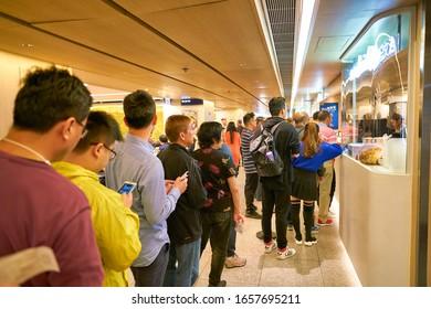 HONG KONG, CHINA - CIRCA JANUARY, 2019: people in line at Cafe De Coral in Hong Kong.