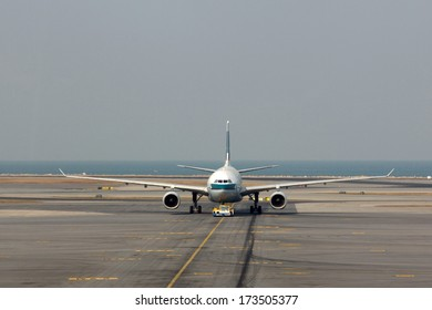 HONG KONG, CHINA - DEC 29, 2013: Cathay Pacific flight in Hong Kong International Airport. About 90 airlines operate flights from HKIA to over 150 cities across the globe.