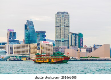 HONG KONG, CHINA - DEC 5: Old classic boat at  Victoria Harbour on December 5, 2014 in Hong Kong, China. With 7M population, it is one of the most dense areas in the world.